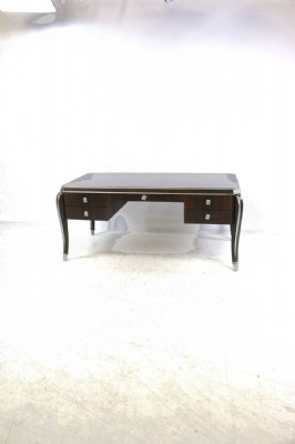Dark Wooden Desk with Silver Gilt Accents.